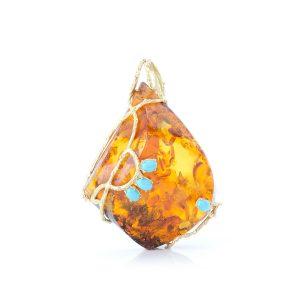 Ciondolo con Ambra 70x48 mm circondata da ramo in Oro 18 Kt e piccoli Cabochon di Turchese Naturale